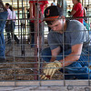 Xander Metcalf, 15, Jasper, helps assemble a pen on Monday in Carthage in preparation for the Jasper County Youth Fair.<br /> Globe | Roger Nomer