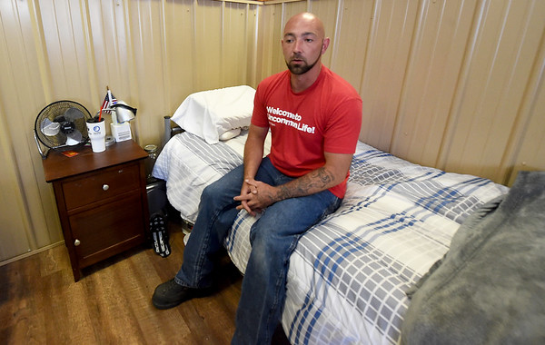 Andrew Milliken, originally from Poplar Bluff, sits on his bunk in the dormitory at Forge as he talks about the changes in his life since being involved in the program. Milliken, 30, said he has secured his GED and for the first time in his life has a driver's license. Milliken is a Phase 2 Forge participant and is close to being graduating to Phase 3, where he will have a private room.<br /> Globe | Laurie Sisk