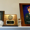 Portraits of  John Cleaver in uniform for both the U.S. Navy and U.S. Army flank a box of his ashes on the mantle of Gold Star Mom, Teresa Cleaver's Webb City home. SSG John Cleaver was killed in Afghanistan in 2009. <br /> Globe | Laurie Sisk