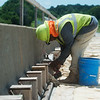 Paul Williams, with Capital, works on a bridge along I-44 on Monday.<br /> Globe | Roger Nomer