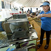 Thao Nguyen, aka Queen of the Sugar Cane, prepares a fresh cold drink from sugar cane on Tuesday. Nguyen, of Our Lady of La Vang Church, Raleigh, N.C., was one of several who worked to provide cold drinks to campers in advance of Marian Days, which opens Thursday at Carthage's Congregation of the Mother of the Redeemer.<br /> Globe | Laurie Sisk