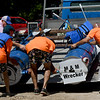 The crew of the M&M Wrecker Tow Boat load their homemade craft after their first race at the Carthage Paddle Battle on Saturday at Kellogg Lake Park. In addition to the fastest craft, awards were presented for most creative craft, best theme with a costume, most likely to sink and a $500 audience choice award. The inaugural event was sponsored by Smith Midwest Real Estate.<br /> Globe | Laurie SIsk