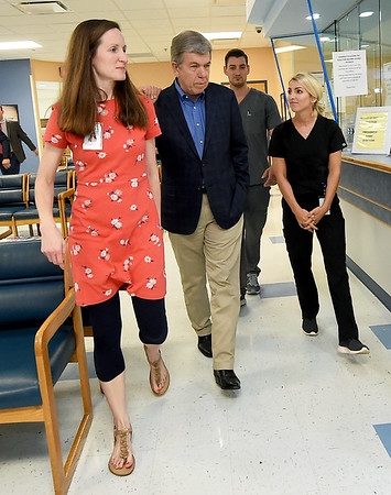 Sen, Roy Blunt visits with Access Family Care doctors (from the left) Kala Smith, Conner Paustian and Bri Phillips during Blunt's tour of the newly expanded clinic on Friday. Access has recently added 26 new exam rooms as part of a partnership with Kansas City University of Medicine and Biosciences.<br /> Globe | Laurie Sisk