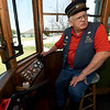 Conductor Jerry Fisher sits at the controls of Streetcar No. 60 as he shares a little history of the trolley last week at King Jack Park in Webb City. The trolley recently recived a new switch enine courtesy of Rick Webb of Watco.<br /> Globe | Laurie SIsk