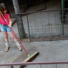 Zannah Grigg, 8, Carthage, sweeps a pen on Monday in Carthage in preparation for the Jasper County Youth Fair.<br /> Globe | Roger Nomer