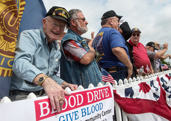 Veterans, including Korean War veteran Ron Stinnett, left, stand to be recognized by the crowd during Thursday's Fourth of July parade in Carl Junction.<br /> Globe | Roger Nomer
