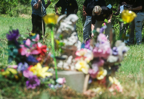 A search area is laid out at a site in Picher near a memorial to Ashley Freeman and Lauria Bible on Tuesday.<br /> Globe | Roger Nomer