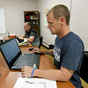 Scotty Robertson, front, originally from Myrtle Beach, S.C. and Royce McNames, from Bentonville, ark., study for their National Career Readiness Certification on Thursday in a classroom at Forge. Robertson said the program has given structure to his life and helped him grow with God.<br /> Globe | Laurie Sisk