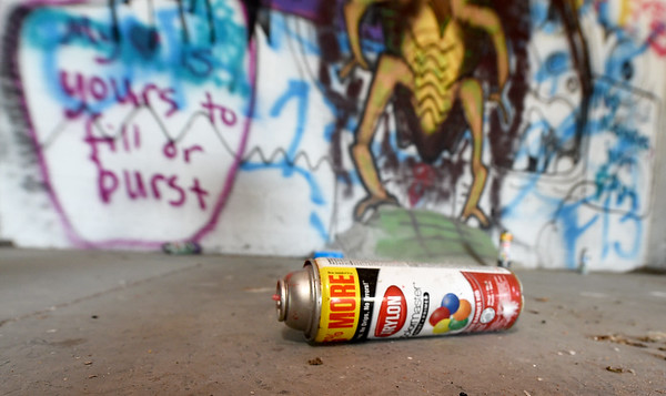 One of several empty cans of spray paint litter the interior of the old Kansas Gas and Electric headquarters on North Locust Street in Pittsburg after taggers spray painted much of the historic brick inside the building.<br /> Globe | Laurie Sisk
