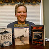 Thirteen-year-old documentary filmmaker sits among some of the materials he used to research his documentary on the Korean War. The award winning documentary centers on action at Funchilin Pass.<br /> Globe | Laurie Sisk