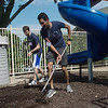 Dane Wilson, a first-year KCU student from Gothenburg, Neb., left, and Ajay Balasubramanyam, a first-year student from Houston, Texas, spread mulch at the Ronald McDonald House during Wednesday's KCU Cares Day.<br /> Globe | Roger Nomer