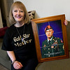Gold Star mom Teresa Cleaver holds a tile portrait of her son, SSG John Cleaver in her Webb City home on Tuesday. SSG Cleaver was killed in Afghanistan in 2009. <br /> Globe | Laurie Sisk