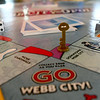 Pieces sit on the board of the new Webb City Opoly game, which includes the classic features of the popular Monopoly game, but is customized to showcase local landmarks and businesses.<br /> Globe | Laurie Sisk