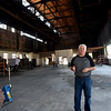 Larry Fields stands inside the old Pittcraft building he is renovating on North Locust Street in Pittsburg. Fields is concerned that the property he is renovating as a family event space across the street may become a target of taggers. Fields hopes to include live stages, dodgeball, simulated golf and pickleball in the event space.<br /> Globe | Laurie Sisk