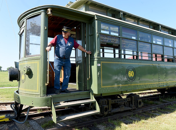 Conductor Clyde Thornbrugh stands atop the stairs of Streetcar No. 60 last week at King Jack Park in Webb City. The trolley recently received a new switch engine courtesy of Rick Webb of Watco.<br /> Globe | Laurie SIsk