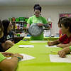 Sarah Serio talks about making custom armor from everyday materials during Friday's artCamp at artCentral in Carthage.<br /> Globe | Roger Nomer