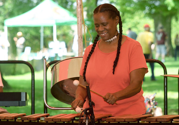 Arlecia Eikamil perform on the marimba with her band during the annual Carver Day on Saturday at Geroge Washington Carver National Monument. The event featured numerous musical acts, exhibits, demonstrations and more.<br /> Globe | Laurie Sisk