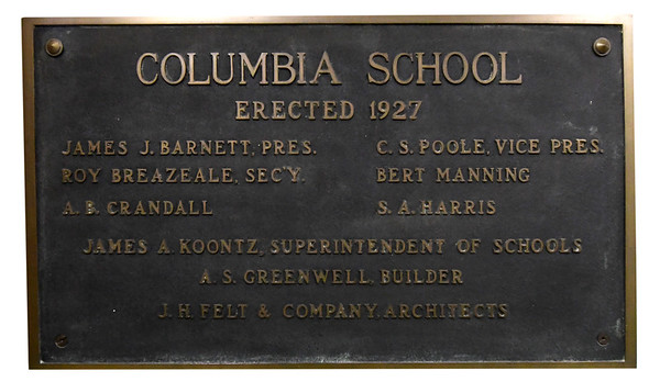 A plaque inside the main entrance of Columbia Elementary comemmorates the opening of the school in 1927.<br /> Globe | Laurie Sisk
