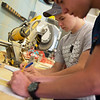 Cole Williams, 14, left, and Grant Williams, 14, work on drafts during Camp AMPED on Wednesday at Crowder College in Neosho.<br /> Globe | Roger Nomer