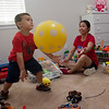 Hazel Bradley plays with her son Vincent, 3, at her home in Jay on June 27.<br /> Globe | Roger Nomer