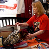 Gold Star Mom Teresa Cleaver shares the stories behind some of the items in what she calls The John Museum on Tuesday in her Webb City home. Cleaver's son, SSG John Cleaver was killed in Afghanistan in 2009. <br /> Globe | Laurie Sisk