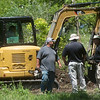 A crew clears brush at a search site in Picher on Tuesday.<br /> Globe | Roger Nomer