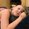"Isis Miller, 8, gets a little cuddle time in with ""Tempy,"" a kitten at the Tiny Tigers Lounge and adoption Center in Northpark Mall on Saturday. The cat lounge will remain open an additional weekend untill Sunday, August 4 at the mall. Hours are Friday & Saturday noon to 7pm and Sunday noon to 6pm.<br /> Globe 
