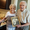Paul and Mary Sue Williams show their wedding photo from 1945 during an interview on Friday.<br /> Globe | Roger Nomer