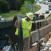 Timothy McKeel, with Capital, works on a bridge along I-44 on Monday.<br /> Globe | Roger Nomer