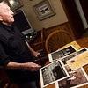 Rex Erisman talks about photos of the lunar landing during an interview on July 10.<br /> Globe | Roger Nomer