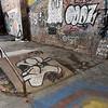 Graffitti covers the walls of the old Kansas Gas and Electric headquarters on North Locust Street in Pittsburg after taggers spray painted much of the historic brick inside the building. Two skateboard ramps also were constructed in the old building.<br /> Globe | Laurie Sisk