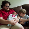 Josh Lewis plays with his children Karter, 2 weeks, and Jase, 3, at his home in Pittsburg on Tuesday.<br /> Globe | Roger Nomer