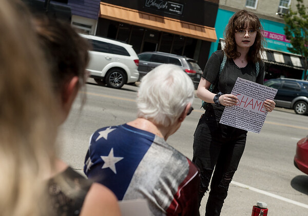 Meghan Hess gives a statement against dentention centers on Tuesday at Sen. Jerry Moran's office in Pittsburg.<br /> Globe | Roger Nomer