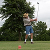Doug Borchardt, Pittsburg, tees off at Schifferdecker Golf Course on Wednesday.<br /> Globe | Roger Nomer