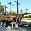 Dave and Sherri Johnson on Friday near Seneca, sit near the large cedar pirate ship playhouse that Dave constructed for their grandson, Julian Summerside, who turns two in September. The couple transported the ship Saturday to Little Rock, Ark., where Julian lives. The ship includes large sails (not pictured) and a treasure chest full of black pearls. <br /> Globe   Laurie Sisk