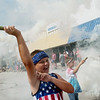 Blake Miller leads a smokey charge on the Fourth of July parade in Carl Junction on Thursday.<br /> Globe | Roger Nomer