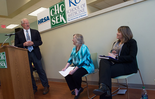 Michael Kennedy, associate dean for rural health education at KUMC, talks with Krista Postai, president and CEO of Community Health Center of Southeast Kansas, and Nancy Rios, deputy regional administrator with HRSA Office of Regional Operations, during a press conference on the grant for rural residency program on Thursday at the Community Health Center of Southeast Kansas.<br /> Globe | Roger Nomer