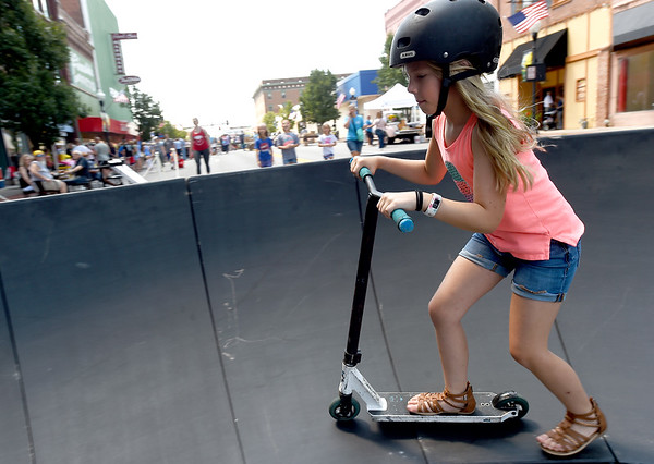 Eight-year-old Bianca Gubera takes a spin on the Progressive Bike Ramps demonstration ramp on Saturday during the annual Downtown Joplin Sidewalk Sale. The event featured a biking event for kids, sales from local shop owners and more.<br /> Globe | Laurie Sisk