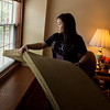 Sharon Nguyen, a KCU first-year student from Dallas, cleans windows at the Ronald McDonald House during Wednesday's KCU Cares Day.<br /> Globe | Roger Nomer