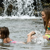 Lektyn Vogt, right, enjoys the day before her seventh birthday with a refreshing swim with her three-year-old sister Kaylen Vogt on Wednesday at Grand Falls.<br /> Globe | Laurie Sisk