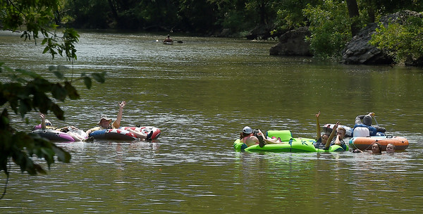 Water enthusiasts take to Shoal Creek at Wildcat Glades for a leisurely float on Wednesday.<br /> Globe | Laurie Sisk
