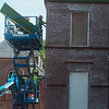Workers with Mid-Continental Restoration Company work with masonry at restoration project of the Schifferdecker House on Tuesday.<br /> Globe | Roger Nomer