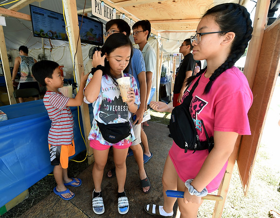 From the left: Paul Dinh, 9, Carolyn Dinh, 12, Brian Dinh, 14, Benjamin Ngyuen, 18 and Catlyn Dinh, 14, get refreshing dinks, including a golden milk tea, center on Tuesday at Carthage's Congregation of the Mother of the Redeemer The annual Marian Days opens Thursday at the church's campus.<br /> Globe | Laurie Sisk