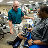 Bobby Smiles works with Frank Eitemiller, physical therapist, at Freeman Sports Rehab on Wednesday.<br /> Globe | Roger Nomer