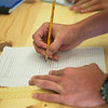 Grant Williams works on a project draft during Camp AMPED on Wednesday at Crowder College in Neosho.<br /> Globe | Roger Nomer