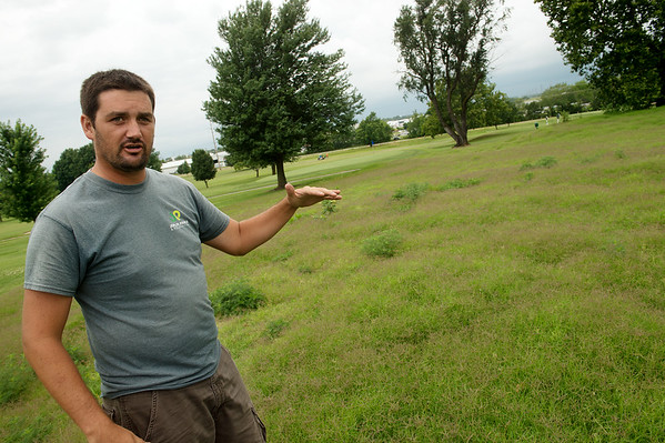 Moran Towse, superintendent of the Schifferdecker Golf Course, talks about prairie growth at the golf course on Wednesday.<br /> Globe | Roger Nomer