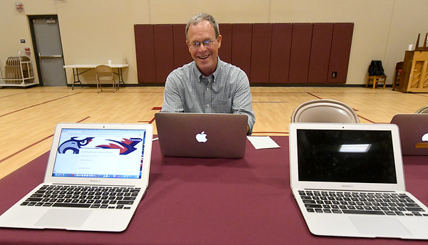 Peter Broglio fills out an online survey after a public input forum on the fate of Columbia and West Central Elementary schools on Thursday night at Columbia Elementary. The forum was one of several conducted during the week.<br /> Globe | Laurie Sisk