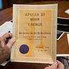 Rex Erisman talks about a certificate he received for witnessing the launch of Apollo 11 during an interview on July 10.<br /> Globe | Roger Nomer
