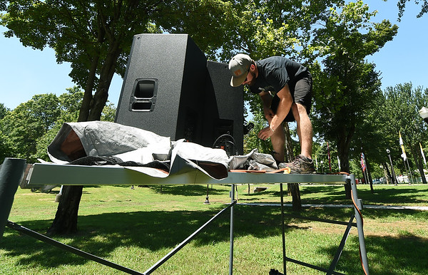 Josh West, of Springfield's Orchard Audio and Visual, installls part of an elaborate speaker system on Tuesday in preparation for Marian Days, which opens Thursday at Carthage's Congregation of the Mother of the Redeemer.<br /> Globe | Laurie Sisk