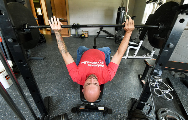 Andrew Milliken, originally from Poplar Bluff, works out in the gym at Forge as he talks about the changes in his life since being involved in the program. Milliken said he likes to exercise as a way of dealing with the daily stresses of life. <br /> Globe | Laurie Sisk